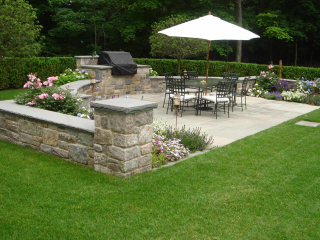 Outdoor Dining Area with Stone Walls and Bluestone Terrace, Greenwich, CT, by Prado Stoneworks