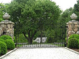 Stone Entranceway Pillars, Greenwich CT, by Prado Stoneworks and Gate by Grand Designs