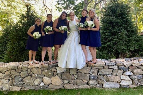 Beautiful bridal party on top of Prado Stoneworks dry stone wall
